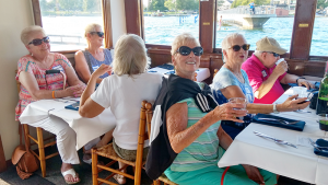 Group activities organized by the East Area Family YMCA include a boat trip on Skaneateles Lake.