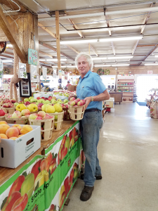 "Dennis Ouellette, owner of Ontario Orchards in Oswego. ""It's a complex process,"" he says of growing a vegetable garden. ""But the rewards usually outweigh the difficult experience."""