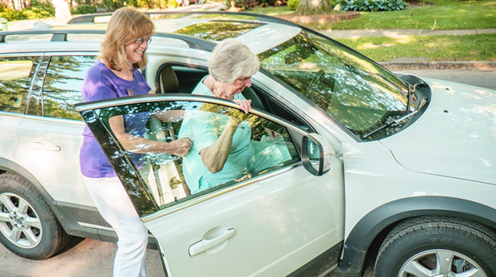 A senior getting a ride with a volunteer. Photo courtesy of Gelfand-Piper Photography.