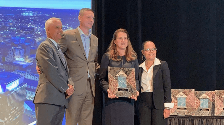 Kate Rolf, president and chief executive officer at Nascentia Health (second from right) accepts CenterState CEO's 2019 Business of the Year Award, nonprofit category, from Joe Convertino, president, C H Insurance (far left); Robert Simpson, president, CenterState CEO (second from left); and Melanie Littlejohn, first vice chairwoman, CenterState CEO, and vice president, New York jurisdiction, National Grid (far right).