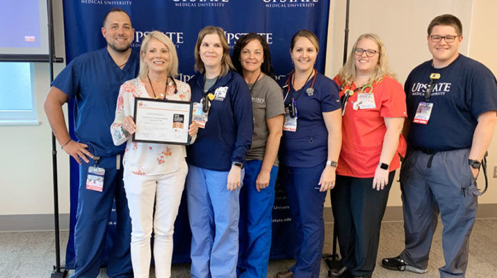 This is the first year the resuscitation team of Upstate University Hospital was honored by the American Heart Association/American Stroke Association. Members, from left are, Matt Grover, resuscitation program coordinator; Ellen Anderson, adult SWAT team/ICU float and support pool nurse manager, resuscitation program manager; Nicole Staring, adult SWAT nurse; Christina Martino, adult SWAT nurse/clinical trainer ICU float & support pool; Colleen Diekemper, adult SWAT nurse; Janice Maggio adult SWAT nurse; and Charles Berardi adult SWAT nurse.