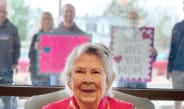 """Loretto has facilitated several """"almost in-person"""" visits between residents and their families. Families stand outside the window of a resident's room at a specified time and are able to establish eye contact. """"Knowing that they are remembered and loved means the world to our residents,"""" says Kim Townsend, chief executive officer at Loretto."""