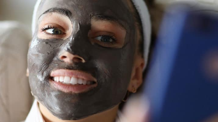 woman with charcoal mask on