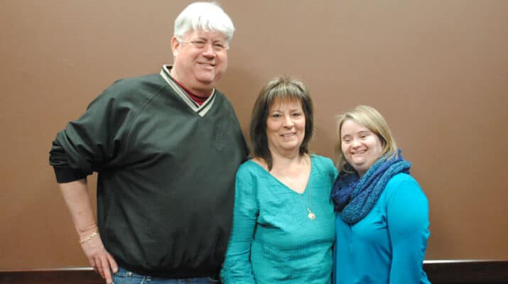Kayla, far right, with her parents, Mark and Patti McKeon.