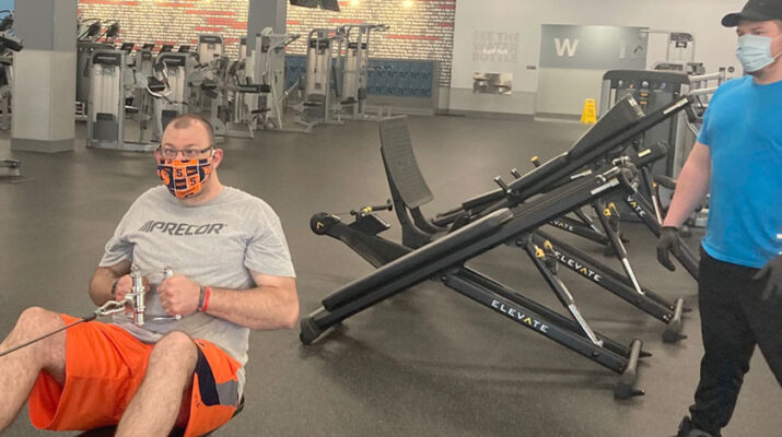 """Brandon Anderson, personal trainer with Blink Fitness in Syracuse (right) working with a client, Michael Ostrander. """"Working out in the morning creates endorphins that help you feel better all day,"""" Anderson says."""