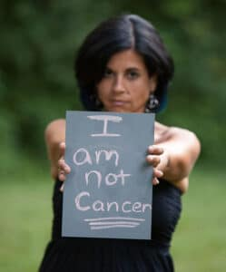 AnnMarie Giannino of Fayetteville holding a sign. Photo courtesy of Genevieve Fridley Photography.