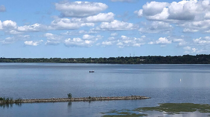 The peak of the West Shore bridge provides a view of the East Flume, a breakwall with restingwaterfowl,the occasional fishing boat and the southeastern shoreline of Onondaga Lake.
